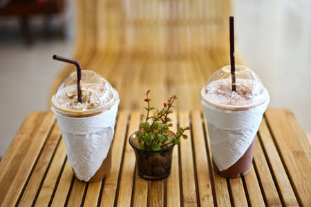 Ice coffee and ice cocoa on wood table