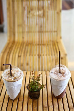 Ice coffee and ice cocoa on wood table  photo