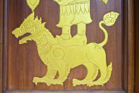 Gold leo on thai church door  photo
