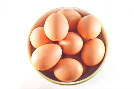Eggs in cup on white background photo