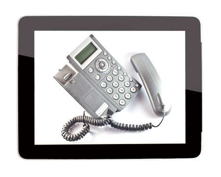 mobile voip: business telephone in tablet  Stock Photo