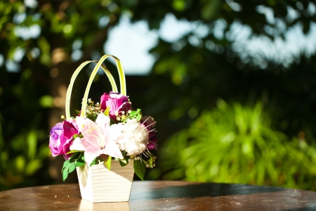 Flower vase on wood table with bokeh  photo
