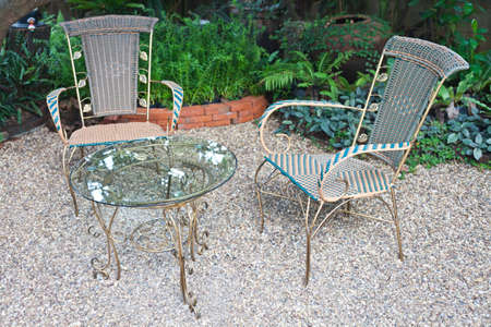 Chair and table in garden for relax time Stock Photo - 16013654