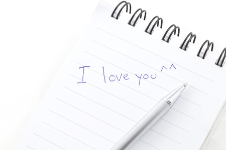 write love word on notebook  photo