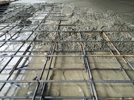 Concrete pouring in construction site