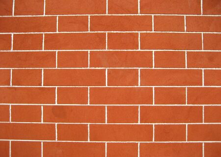 A wall is a usually solid structure that defines and sometimes protects an area.  photo