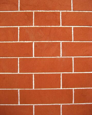 defines: A wall is a usually solid structure that defines and sometimes protects an area.
