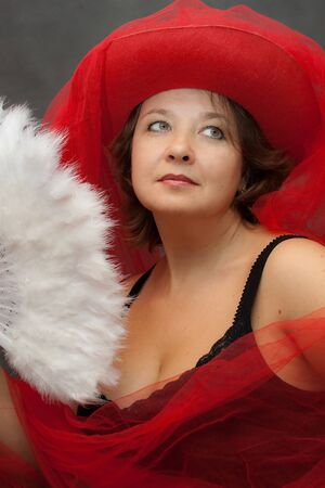 We see Woman in red hat with white fan Stock Photo - 10459064