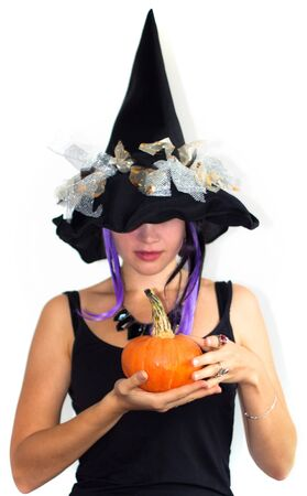 Young pretty witch with small pumpkin Stock Photo - 10689705