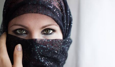 we see Muslim Veiled Woman With A Burqa