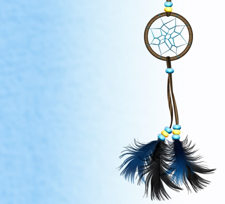 Image of a Native American dreamcatcher on blue background photo
