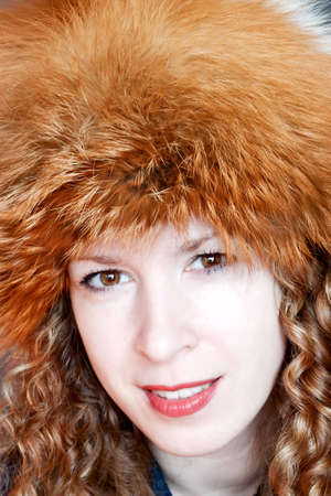 Beautiful young woman posing in big russian style fur hat Stock Photo - 12776227