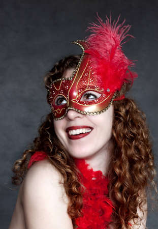 Lady in a red mysterious venetian mask Stock Photo - 12776229