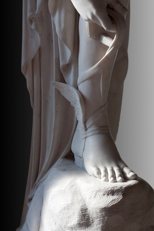 Marble statue of Talaria (winged sandals) of greek god Hermes