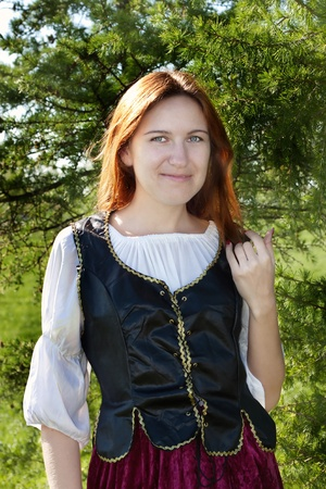 middle age women: Medieval woman standing near the fir Stock Photo