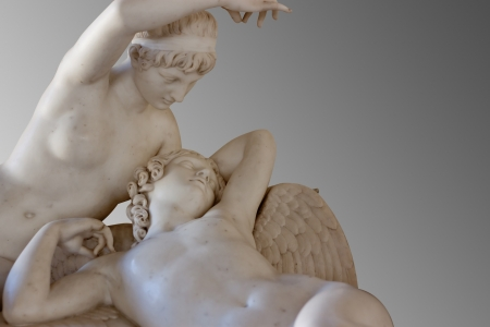 Marble statues of Cupid and Psyche on gray background with clipping path photo
