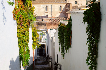 Photo of old street in a historic center of Granada city, Andalusia region, Spain.