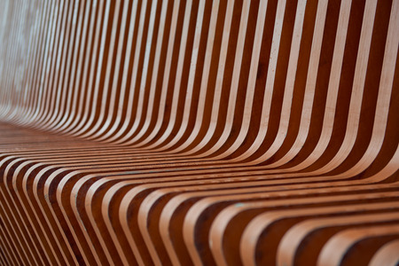timber bench seat: A close up of a wooden bench