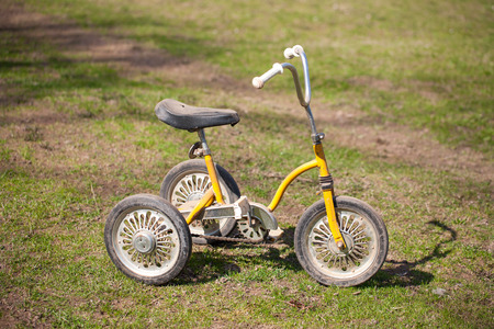 tricycle: Vintage kids tricycle Stock Photo