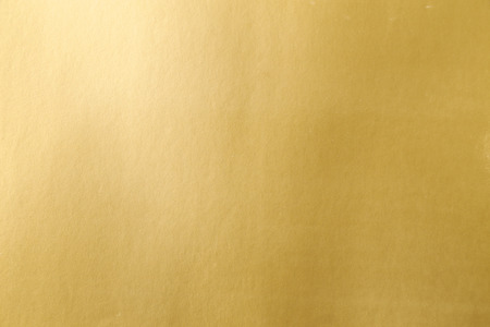 Gold paper texture or background Imagens