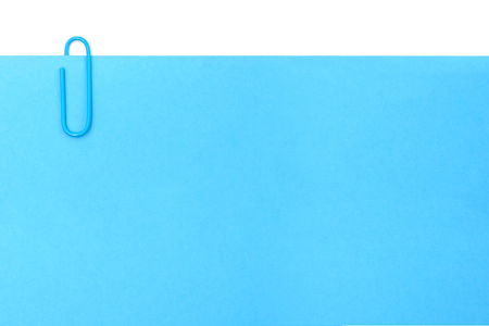 clip with blue paper on white background