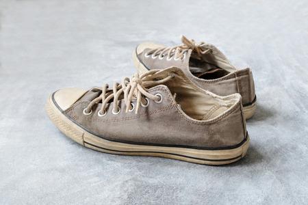 Old sneakers on concrete floor