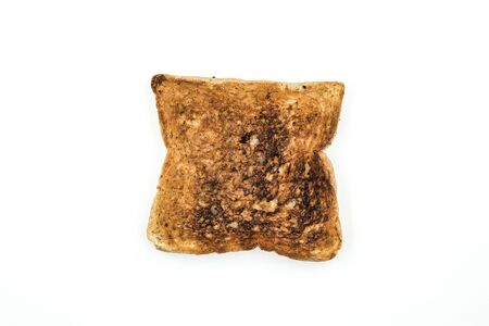 Burned bread on white background