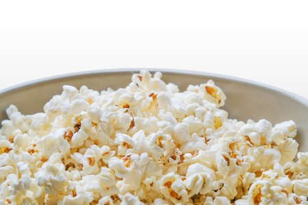 Popcorn in a bowl on white background