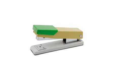 Green stapler at Staples on white background
