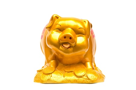 Golden Piggy bank isolated on a white background