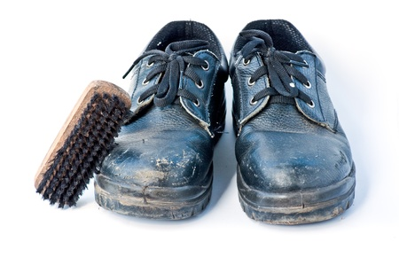old Safety shoes and brush on the white background photo