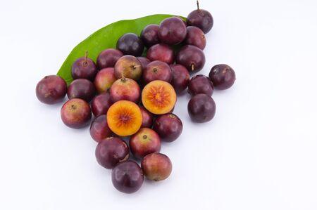 Flacourtia jangomas  tropical fruit on the white background