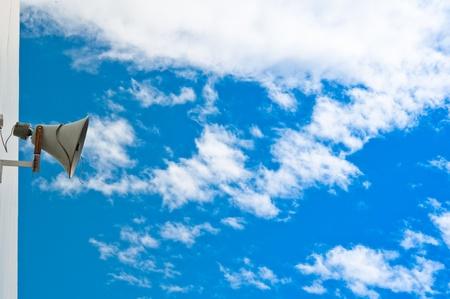 old loudspeaker and sky