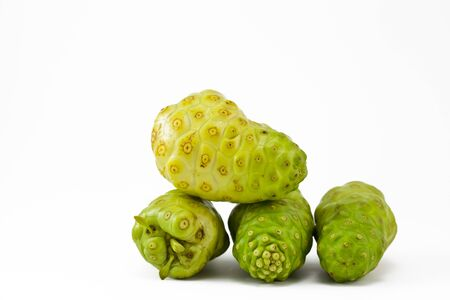 noni fruit on a white background