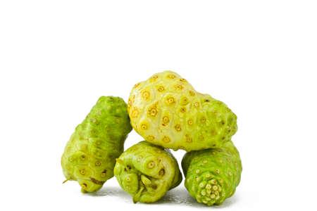 noni fruit on a white background photo