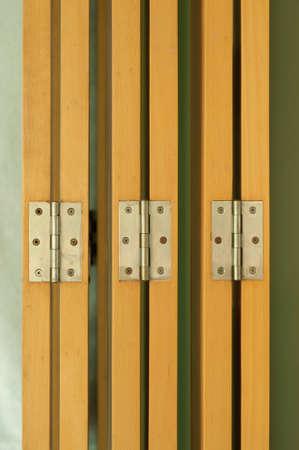hinges on beige wood door