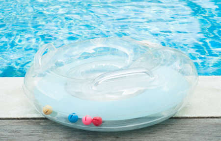 rubber ring on swimming pool edge Stock Photo