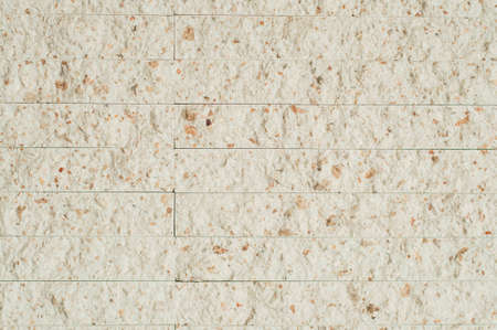 beige rexstone tile on the wall