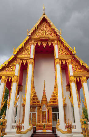 infront of the thai temtple in cloudy