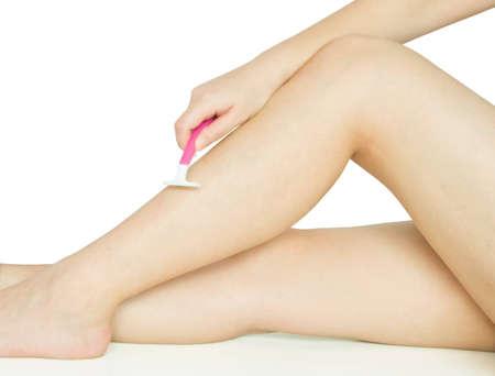 girl shaving leg on white background Stock Photo - 10689628