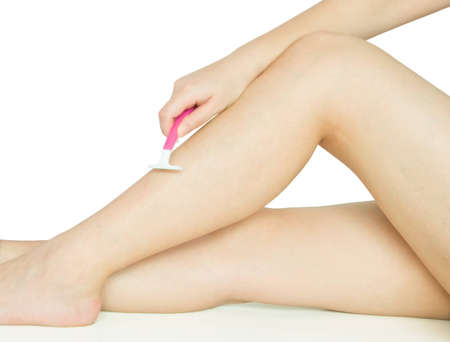 girl shaving leg on white background