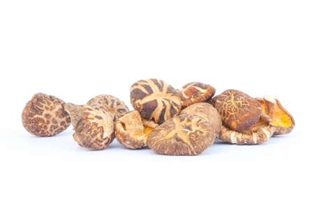pile of asian dry mushroom on white floor photo