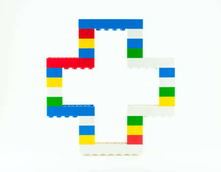 stack of toy pieces to the color plus sign Stock Photo - 12686375