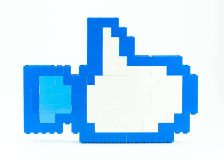 stack of toy pieces to to the like symbol Stock Photo - 12686378