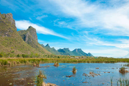 swamp land front of the mountain with beautiful sky Stock Photo