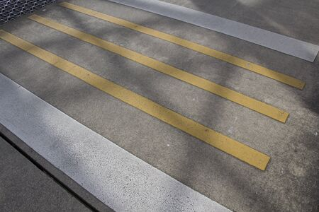Shadow on Yellow And White Crosswalk