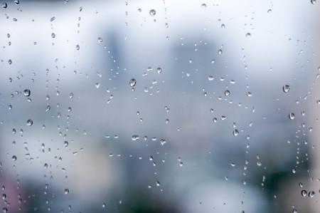 water drop on a window on rainy day Stock Photo