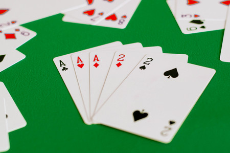 full house ace and two, poker card in green background Stok Fotoğraf