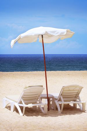 deserted: Two chairs and umbrella Stock Photo