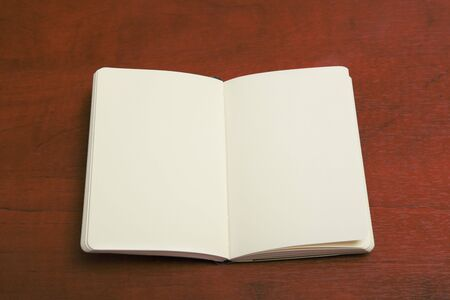 blanck: Open notebook on wood table